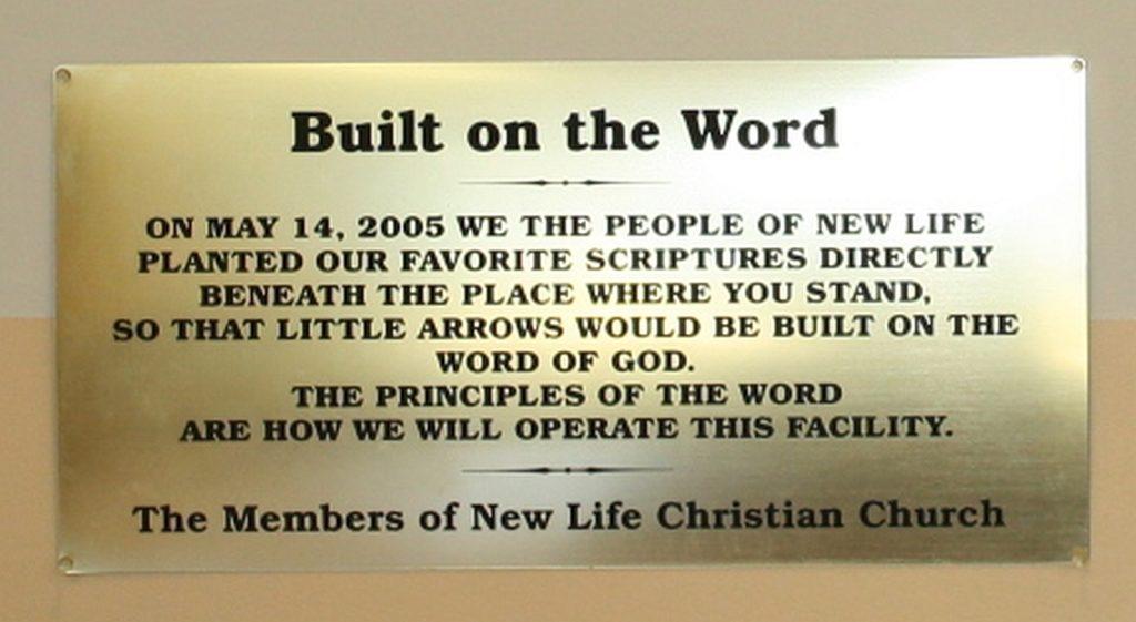 New Life Christian Church dedication plaque inside Little Arrows facility.